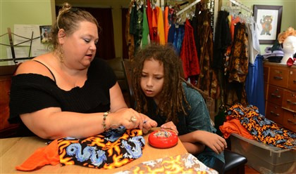 Suz Pisano and Windafire Designer Suz Pisano works with Windafire on one of his clothing designs at his home in Point Breeze.