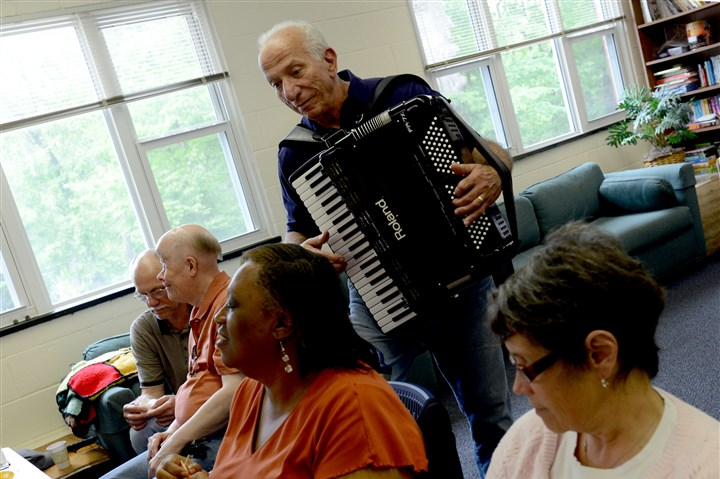 20140528ppFriendshipGroupLOCAL Lou Gamber from Gibsonia plays happy birthday on the accordion while other members from the women's knitting group and the men's group socialize during the celebration at the Berkely Hills Lutheran Church. The Friendship Group, an all volunteer non-profit gets the groups together made up of local residents who are visually impaired, legally blind and those who are experiencing vision loss.