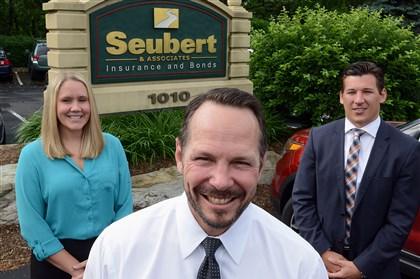 Seubert & Associates Kristie Lulich, Brian Long and Brandon Mueller Seubert & Associates President Brian Long's (center) succession plan has him being replaced by Kristie Lulich, left, and Brandon Mueller. Mr. Long will return to his first job with agency, a salesman.