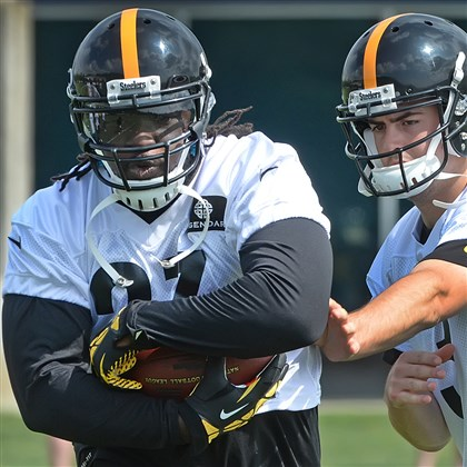 Steelers running back LeGarrette Blount Steelers running back LeGarrette Blount takes a handoff from backup quarterback Landry Jones during OTA workouts earlier this month at the team's practice facility on the South Side.
