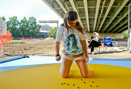 20140603MWHmarblesLocal03-2 Fourteen-year-old Kelsey Baran, of Allison Park, practices for her trip to the National Marbles Championship underneath the Bloomfield Bridge on Tuesday, June 3.