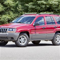 Chrysler-Investigation FILE - This undated file photo provided by Chrysler shows the 2002 Jeep Grand Cherokee. U.S. safety regulators are investigating whether a 2012 recall of 745,000 older-model Jeep Grand Cherokees and Libertys to fix air bags is working. The investigation affects Libertys from the 2002 and 2003 model years and Grand Cherokees from 2002 to 2004. (AP Photo/Chrysler, File)
