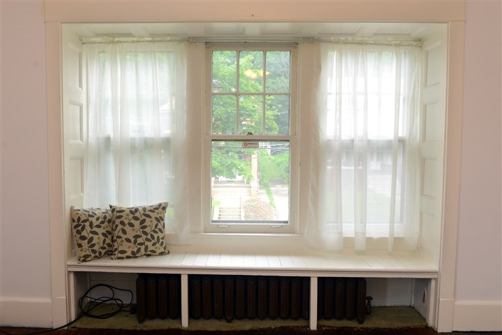 A window seat covers a radiator A window seat covers a radiator in one of the second floor bedrooms.