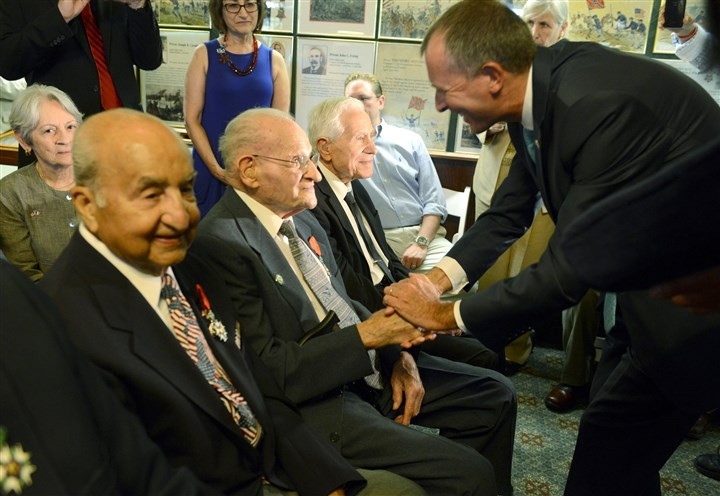 20140603bwFrenchLocal07-3 From left, August Pace, 90, of Bethel Park; Ralph Russo, 96, of New Castle; and Michael Vernillo, 96, of the North Side are among the nine awarded the French Legion of Honor. French consul general Olivier Serot Almeras, right, is greeting Mr. Russo.