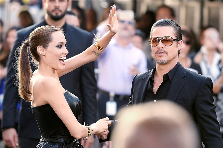 "pitt Angelina Jolie and Brad Pitt arrive for the world premiere of Disney's ""Maleficent"" last week at El Capitan Theatre in Hollywood, Calif."
