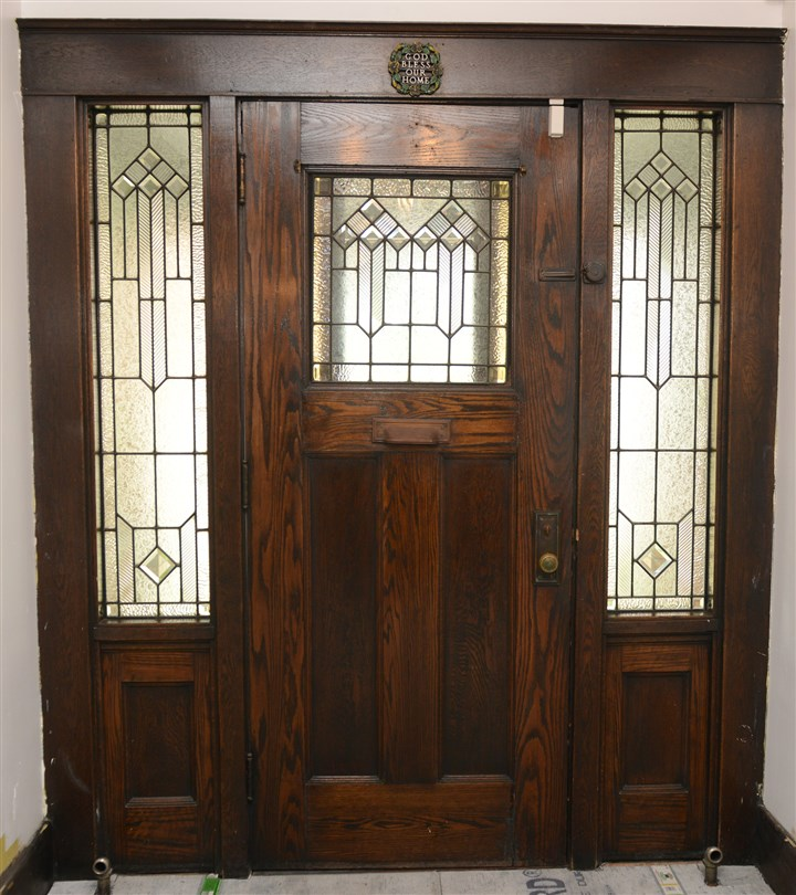 The original doors The original doors with leaded stained glass and rich wood panels