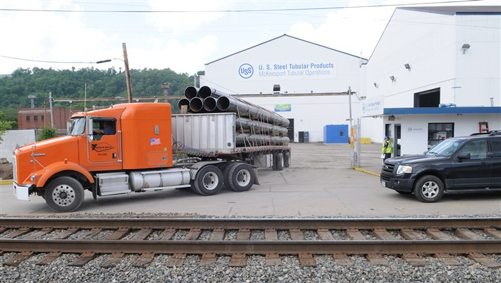 20140603CMUSSteelLocal001 A truck carrying steel pipe leaves the U.S. Steel McKeesport Tubular Operations facility on Tuesday.
