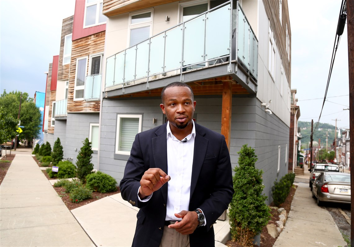 Emeka Owugbenu In Front Of One Of His Development Properties In  Lawrenceville 3 Pittsburgh's New Immigrants: