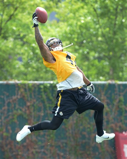 Antwon Blake goes high for a ball  Antwon Blake goes high for a ball during an OTA drill this past week.
