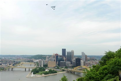 20140604MWHangelsLocal07-4 The Blue Angels fly over Pittsburgh Wednesday afternoon.