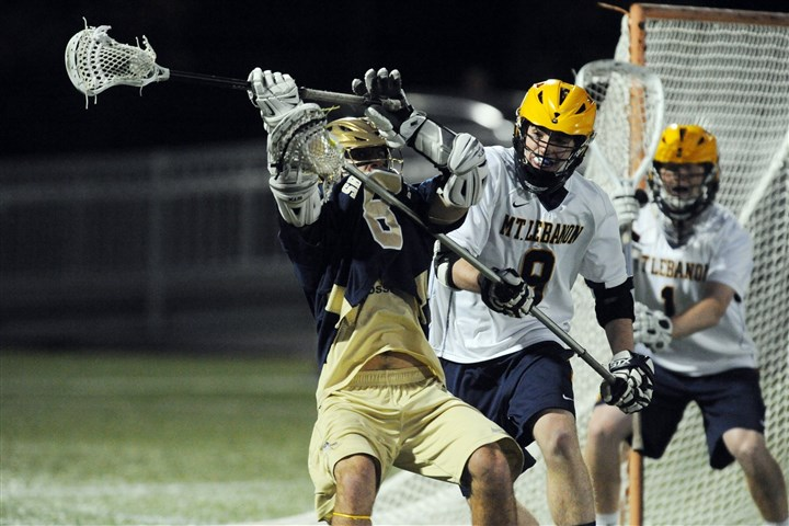 20140523bwLebanonSpts03 Shady Side Academy's Michael Concordia, left, is defended by Mt. Lebanon long-stick defenseman Tim Donoghue during WPIAL Division I championship match at Highmark Stadium.