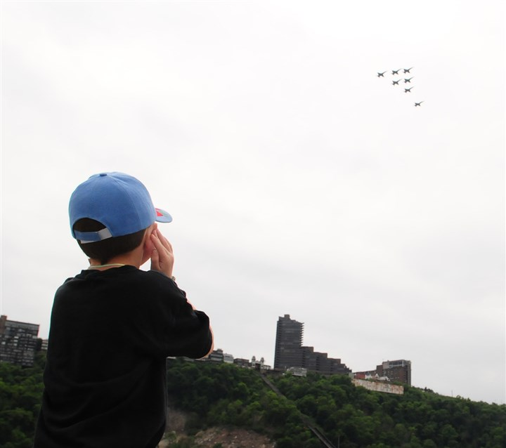 20140603CMBlueAngelslLocal002-1 James Lynn, 5, of New Stanton covers his ears as the Blue Angels, the U.S. Navy's stunt team, fly over Mount Washington.
