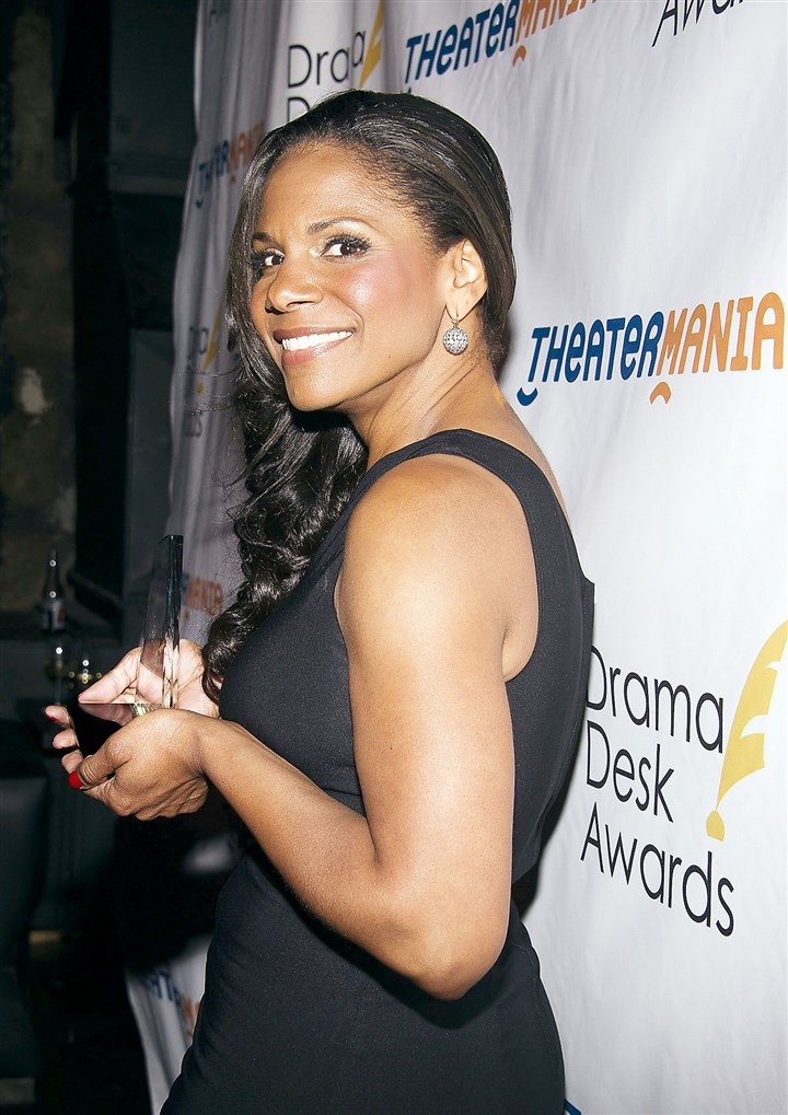 "Audra McDonald Audra McDonald poses with her award for ""Outstanding Actress in a Play"" in ""Labor Day at Emerson's Bar and Grill."""