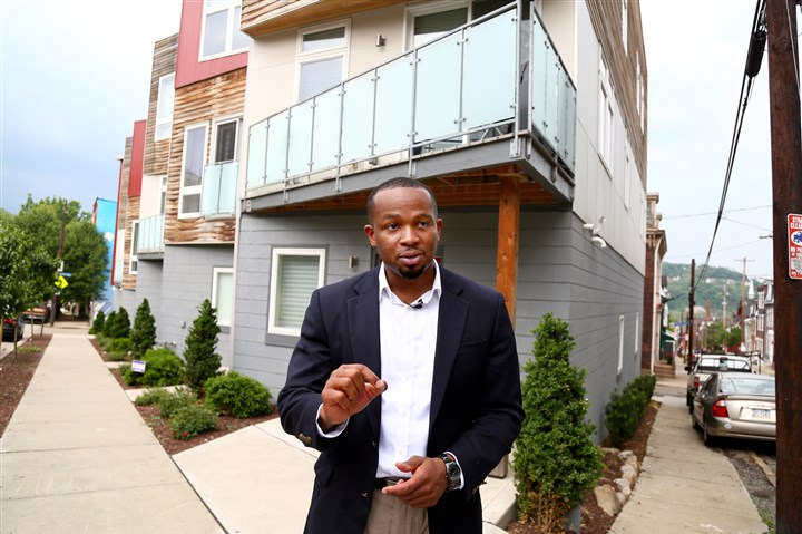 Emeka Owugbenu Emeka Owugbenu in front of one of his development properties in Lawrenceville.