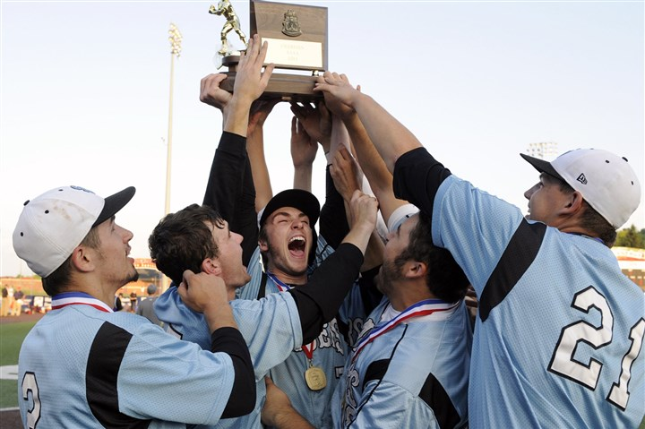 20140529mfsenecasports02.jpg Seneca Valley teammates hoist their trophy after defeating Baldwin in the WPIAL Class AAAA championship Thursday.