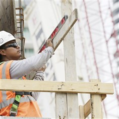 Productivity A construction worker works on the site of the SoMa at Brickell apartment building in downtown Miami. The Labor Department reports revised figures for productivity in the first quarter Wednesday.