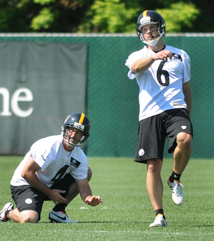 20140605CMSteelerslSports001 Steelers punter Adam Podlesh watches the ball fly through the air as kicker Shaun Suisham follows through on a field goal attempt at the Steelers' South Side practice field.