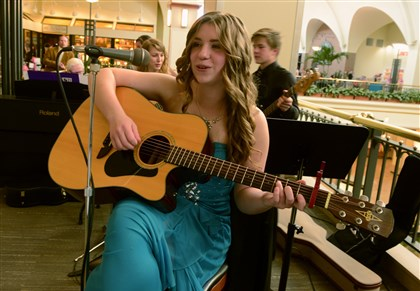 "20140605bwGalaLocal02 Stephanie Brown,15, of Mt. Lebanon, a member of St. Paul's Episcopal Church, plays before the screening of ""The Fault in Our Stars"" at the Galleria theater in Mt. Lebanon."