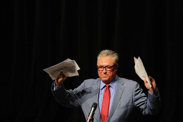 "20140605rldBaccalaureate02 Pirates manager Clint Hurdle holds up his notes from the meditation he gave at the Franklin Regional 2014 senior class baccalaureate service at the high school in Murrysville. He said it was ""a love letter from me to you."""