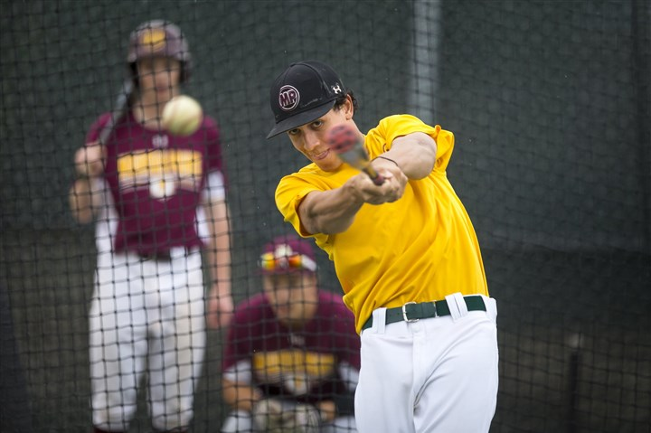 tucker55-2 Mountain Pointe High School's shortstop Cole Tucker takes batting practice April 2.