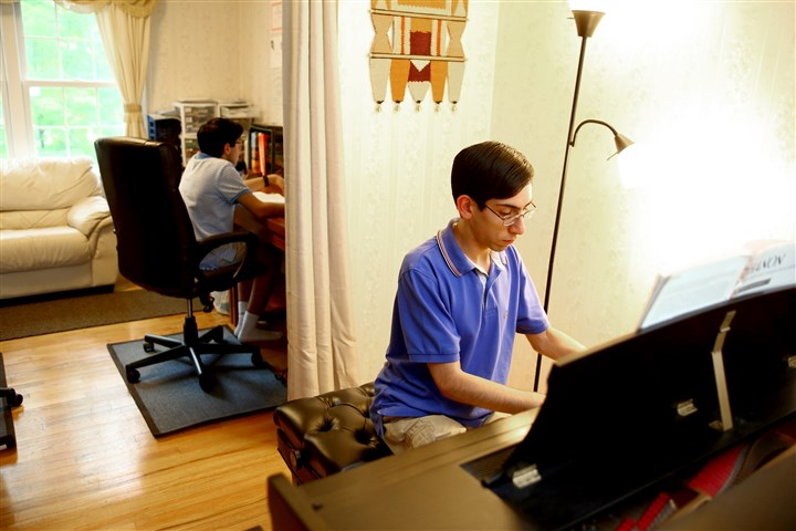 201406_SmartStudents002-1 Rishi Mirchandani practices piano while his brother Suvir studies at their O'Hara home. Rishi will perform next season with the Pittsburgh Symphony Orchestra.