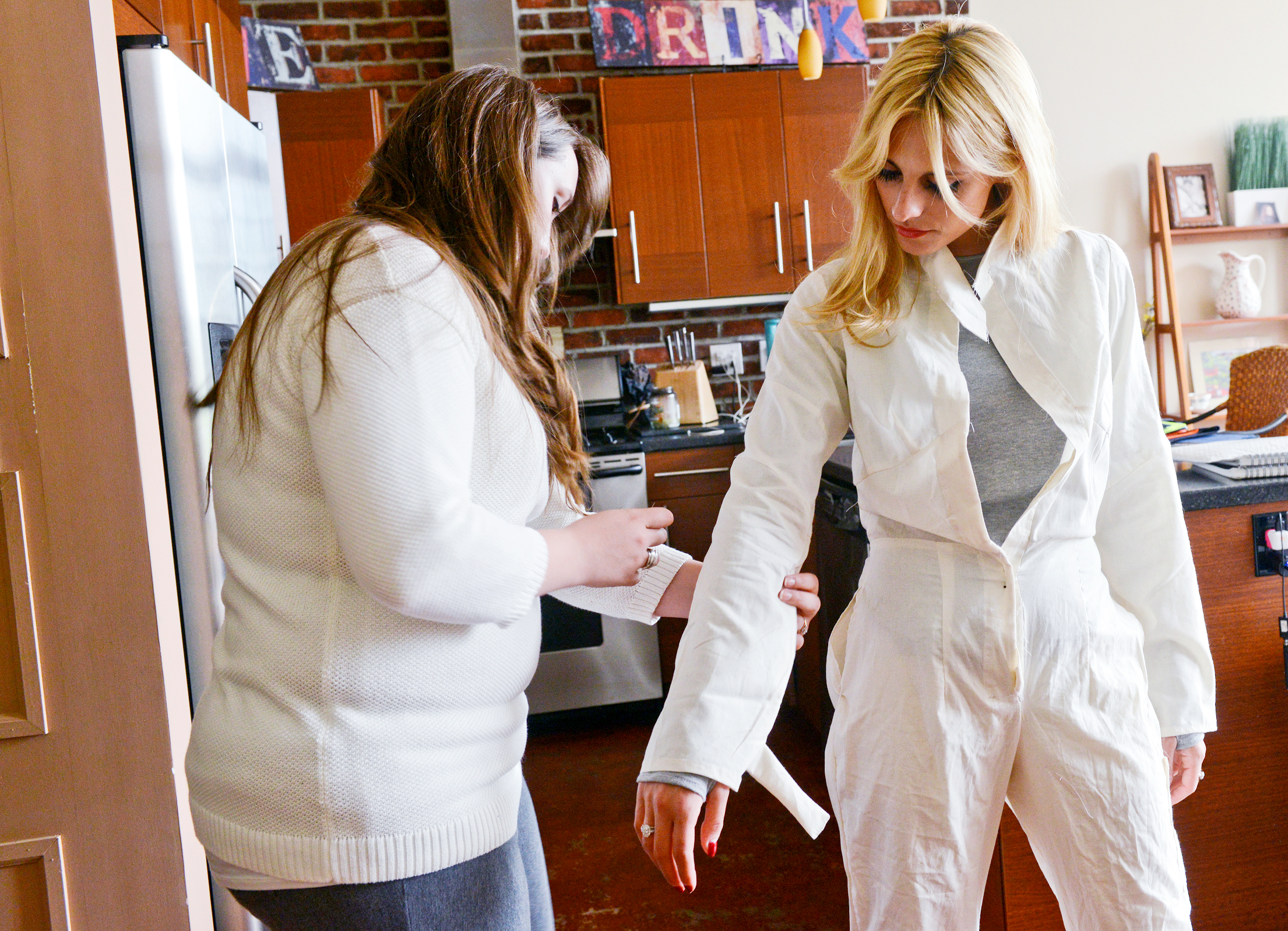 20140605rldFireWithin02-1 Designer Christina Knieriem tailors a prototype for fire resistant coverall made specifically to fit women.