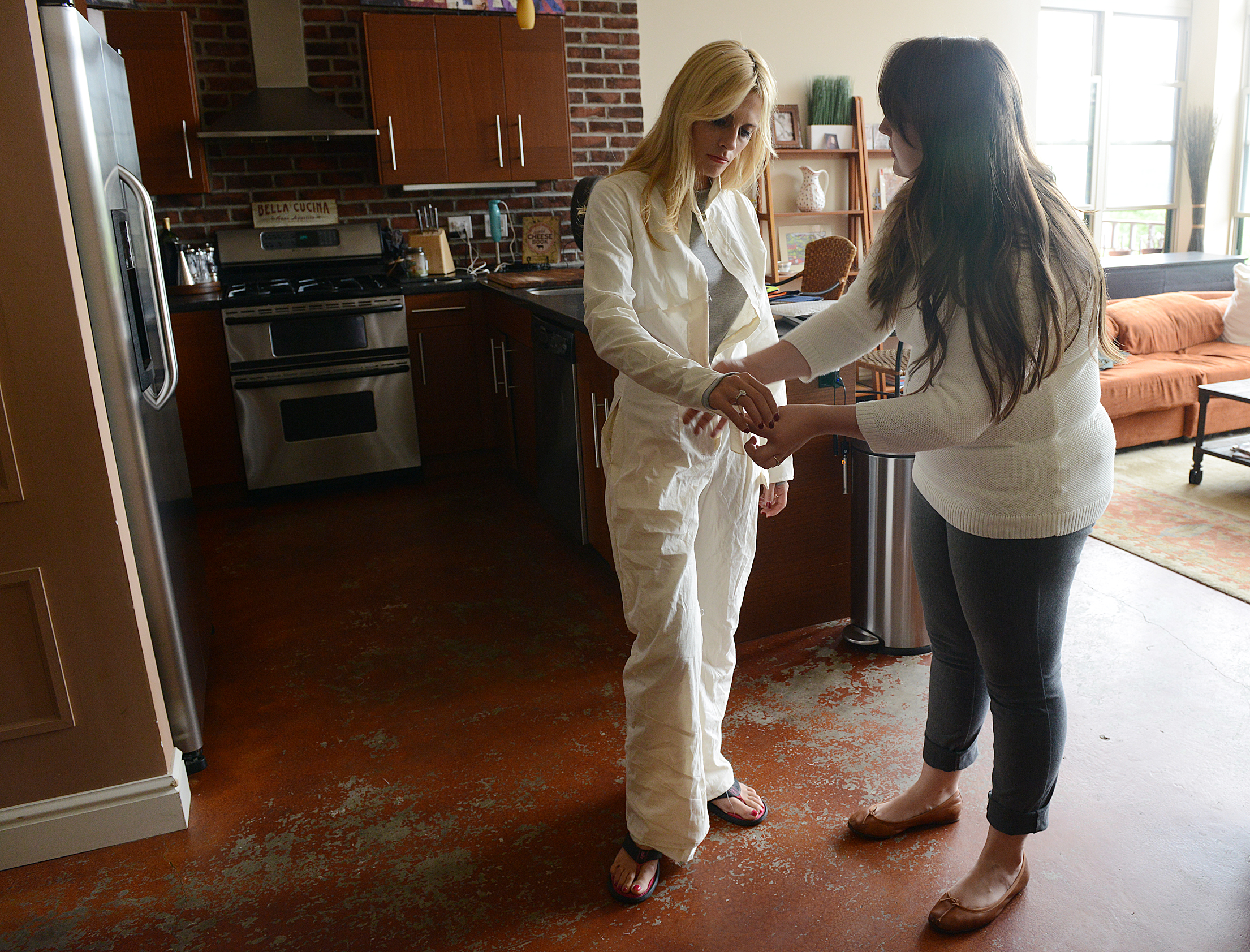 20140605rldFireWithin03-2 Amelia Papapetropoulos, left, is working with designer Christina Knieriem, to create the first sample of a fire resistant coverall made specifically to be flattering for women.
