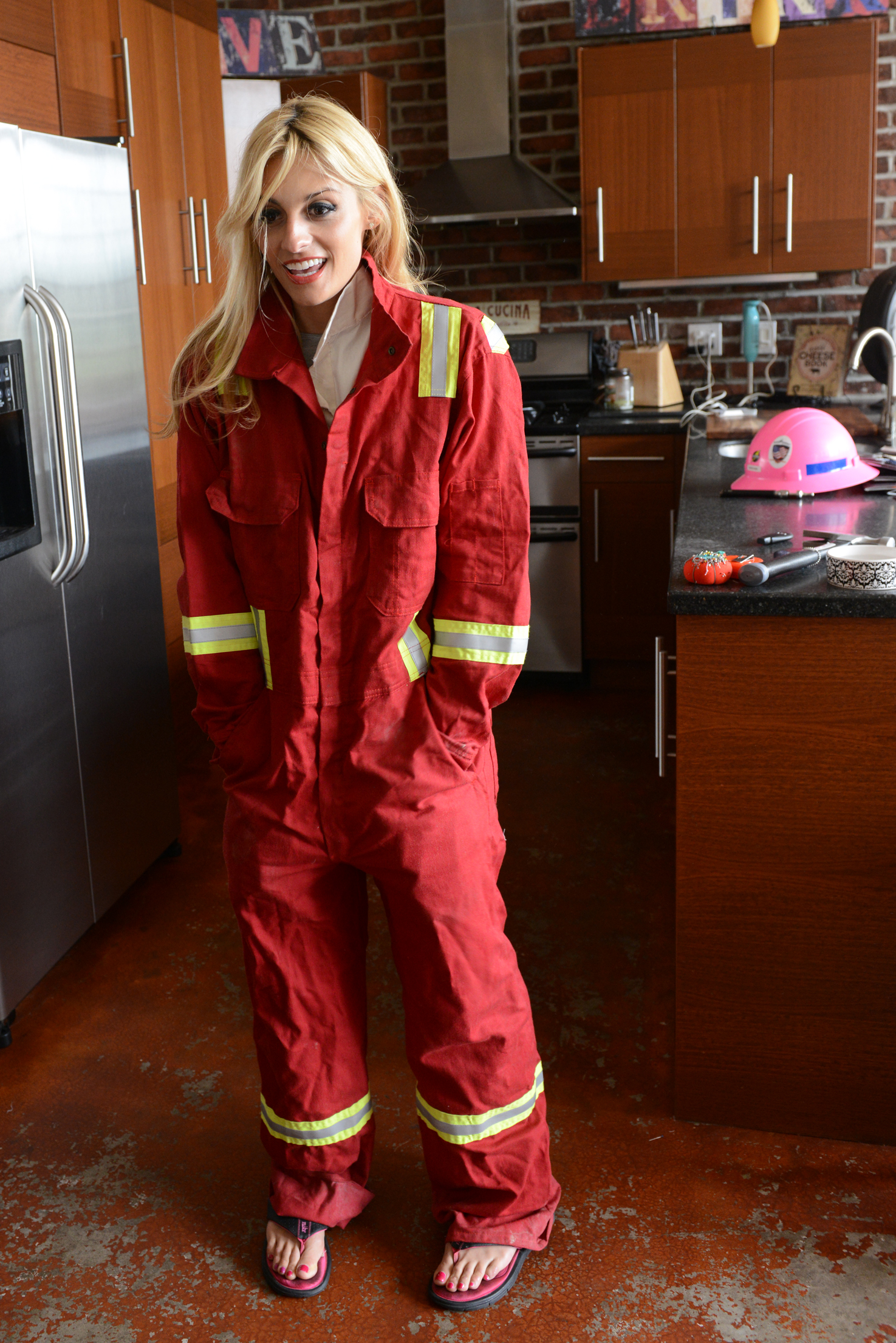 "20140605rldFireWithin04-3 Amelia Papapetropoulos of the South Side Slopes founded ""Fire Within"" to create clothing for women in the oil and natural gas industry. She demonstrates how the existing fire resistant coveralls not only aren't flattering but proportionally don't fit her."