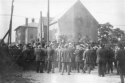 strikers at St. Anselm Church  A man addresses strikers at St. Anselm Church.