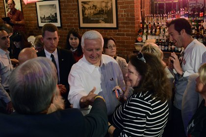 Corbett Gov. Tom Corbett greets supporters during a campaign stop at the Primanti's restaurant in the Strip District today. New Jersey Gov. Chris Christie accompanied the governor, who is seeking re-election in November.