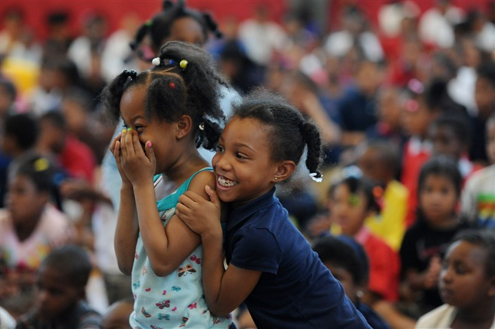 20140606rldFaisonAttendance02-2 First graders Davaisha Bush, left, and Miranda Diggs react as their names are called during the United Way Be There 30-Day Challenge ceremony honoring students' attendance at Pittsburgh Faison K-5 in Homewood on Friday.
