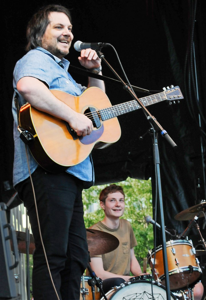 20140606CMTweedyMag001 Jeff Tweedy of Wilco performs with his son Spencer on the drums at the Three Rivers Arts Festival at Point State Park Friday night.