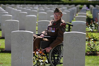 Normandy veteran Ken Scott Normandy veteran Ken Scott, 98, who was a British infantry sergeant with the Durham Light Infantry on Gold Beach on D-Day, looks at headstones Friday in Bayeux Cemetery during commemorations marking the 70th anniversary of the World War II landings in France.