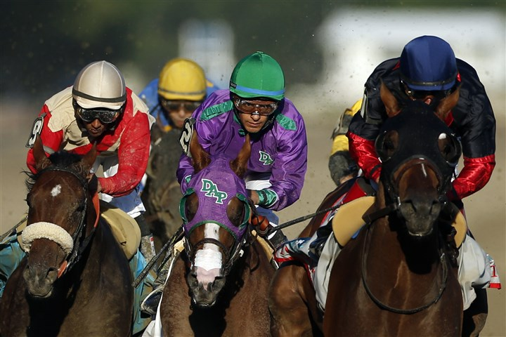 California Chrome, left, runs behind Tonalist California Chrome, left, runs behind Tonalist, right, as they make their way down the backstretch Saturday during the Belmont Stakes at Belmont Park in Elmont, N.Y. Tonalist won the race, denying California Chrome the Triple Crown.