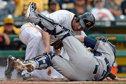 walkertag0609 Pirates second baseman Neil Walker is tagged out at home plate by Brewers catcher Jonathan Lucroy in the first inning Sunday at PNC Park.