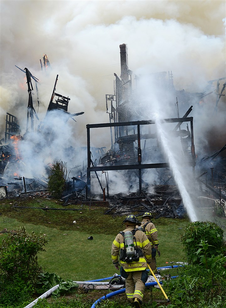 Skeletons of houses after Mount Oliver fire Firefighters battle a multiple-alarm blaze that destroyed several homes.