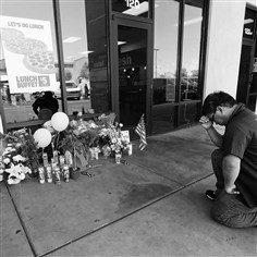 450347342 Jonathan Solano of Nevada prays at a memorial Monday outside CiCi's Pizza in Las Vegas. The Las Vegas Metropolitan Police Department said Officers Alyn Beck and Igor Soldo were shot and killed at the restaurant by Jerad Miller and his wife, Amanda Miller. Police said the Millers then went into a nearby Walmart, where Amanda Miller killed Joseph Wilcox before the Millers killed themselves.
