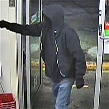7-11 robbery2a.jpg Surveillance video shows a man who robbed a 7 Eleven on Thompson Run Road in Ross Township.