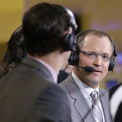 bylsma0610 Former Penguins coach Dan Bylsma talks during a live broadcast for the NHL Network before Game 3 of the NHL hockey Stanley Cup Final between the Los Angeles Kings and New York Rangers, Monday, June 9, 2014, in New York. Bylsma was fired by the Penguins on Friday.