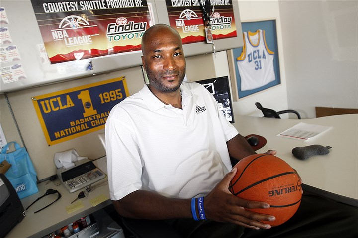 ncaa2_nat Former UCLA basketball player Ed O'Bannon Jr. sits in his office in Henderson, Nev., in 2010. Five years after the former UCLA star filed his antitrust lawsuit against the NCAA, he began the trial Monday with his testimony.