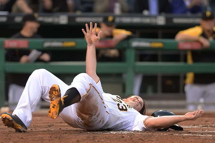 20140609pdPiratesSports05-1 Travis Snider slides home safely to score against the Cubs at PNC Park.