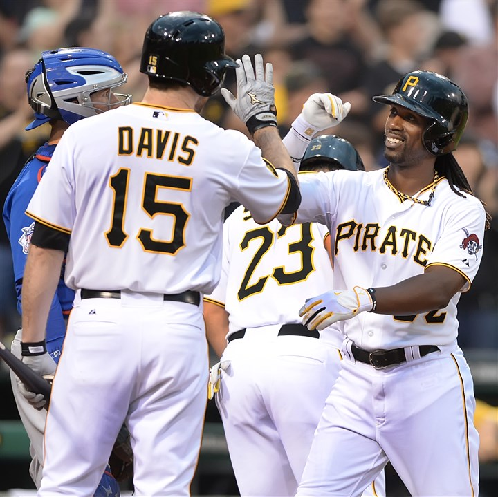 Andrew McCutchen  Andrew McCutchen high fives teammate Ike Davis after hitting a two-run home run in the third inning at PNC Park Monday night against the Chicago Cubs in Pittsburgh.