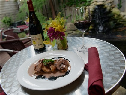 20140610ppTABLE0612WKNDMAG1 Sauteed crispy sweetbreads with red wine mushroom sauce and wine on the back patio of Open Bottle Bistro on Ellsworth Avenue in Shadyside.