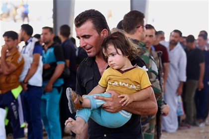 Mideast Iraq .JPEG-06ad8 Refugees fleeing from Mosul head to the self-ruled northern Kurdish region in Irbil, Iraq, 217 miles north of Baghdad, Tuesday, June 10, 2014. Islamic militants overran parts of Iraq's second-largest city of Mosul on Tuesday.