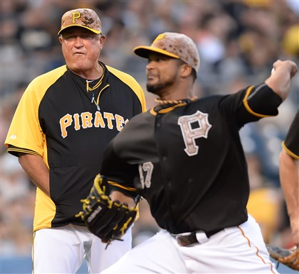 bucsnot2 Pirates manager Clint Hurdle watches starting pitcher Fancisco Liriano deliver to the plate Tuesday. Liriano was placed on the DL with a strained oblique..