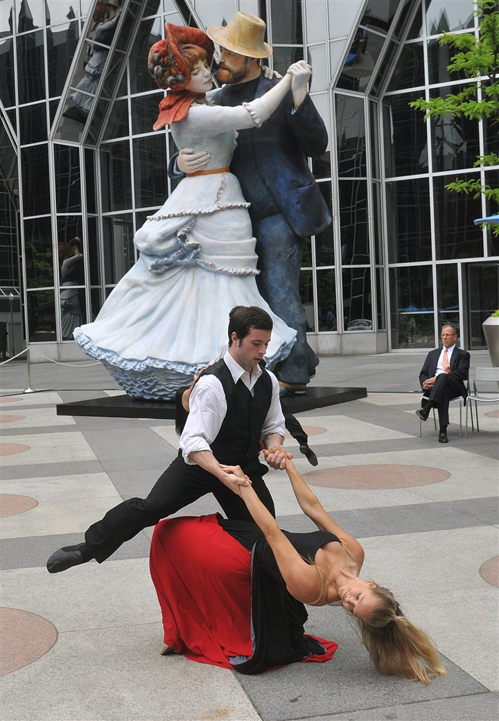 "20140610lrjohnsonstandalone07 Dancers from Point Park University Conservatory Dance Company perform in front of the Seward Johnson sculpture ""A Turn of the Century "" after the ribbon-cutting ceremony today. The monumental piece interprets Pierre-Auguste Renoir's ""Dance at Bougival."""
