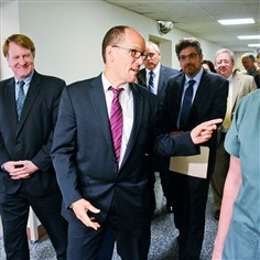 20140611lfLaborBusiness01 US Labor Secretary Thomas E. Perez, center, tours the Allegheny General Hospital on Wednesday in the North Side with Allegheny County Executive Rich Fitzgerald, left, and RN Jane Miller, right.