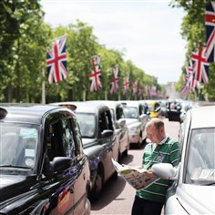 A London taxi driver on The Mall during a protest against Uber A London taxi driver on The Mall during a protest against Uber, the smartphone car-paging service