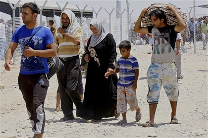 Mideast Iraq Refugees fleeing from Mosul head to the self-ruled northern Kurdish region in Irbil, Iraq, 217 miles north of Baghdad, Tuesday when Islamic militants overran parts of Iraq's second-largest city of Mosul.