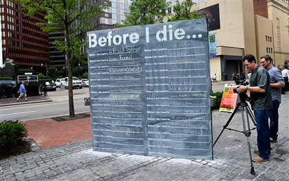 "20140610lrtrafdiemag01 A crew from 7 Line Media films the ""Before I Die"" blackboard set up in Katz Plaza during the Three Rivers Arts Festival."